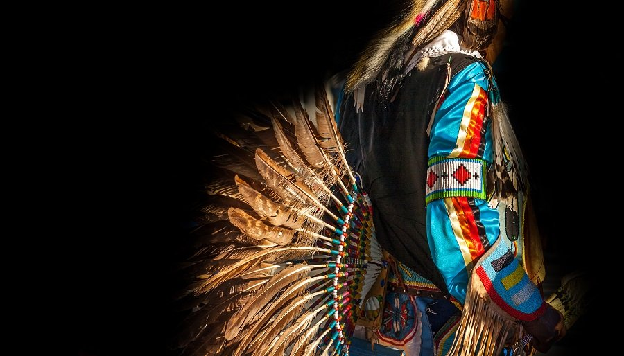 Native American Indian colorful dressed native man.