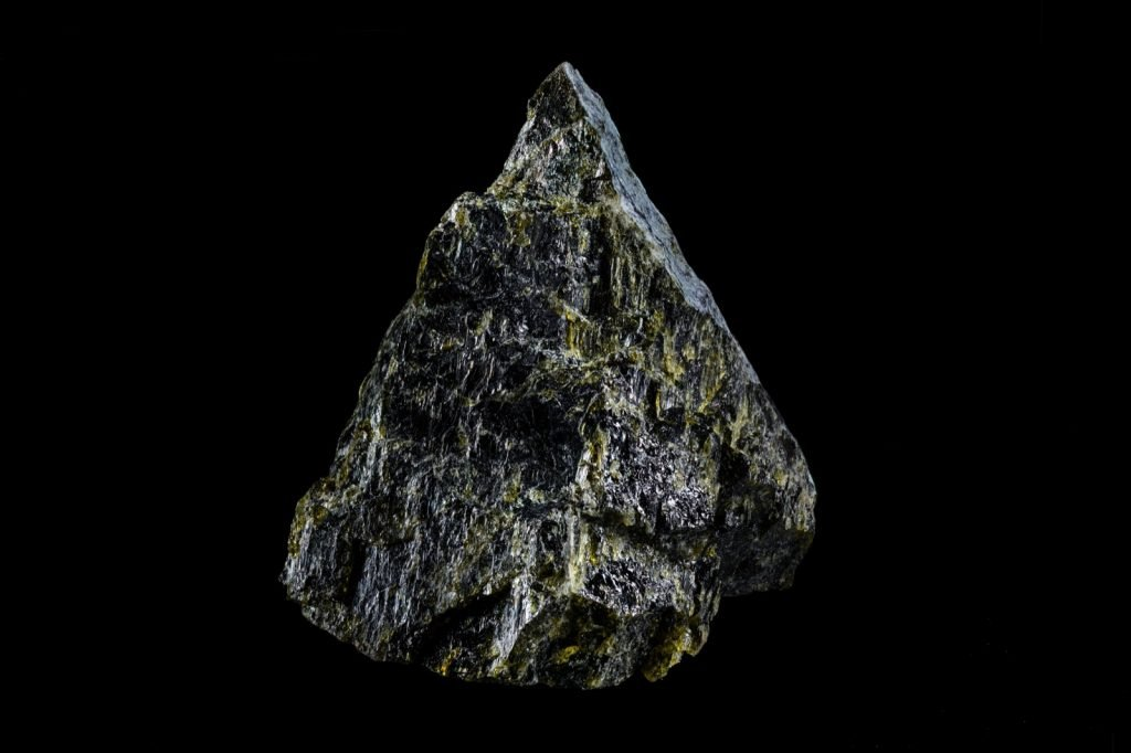 Natural diopside mineral stone isolated on a black background