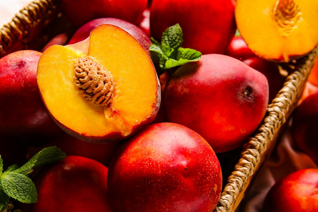 Fresh ripe nectarines in a wicker box