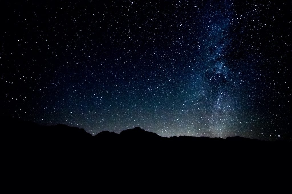 Night view from the mountains with stars on the black sky