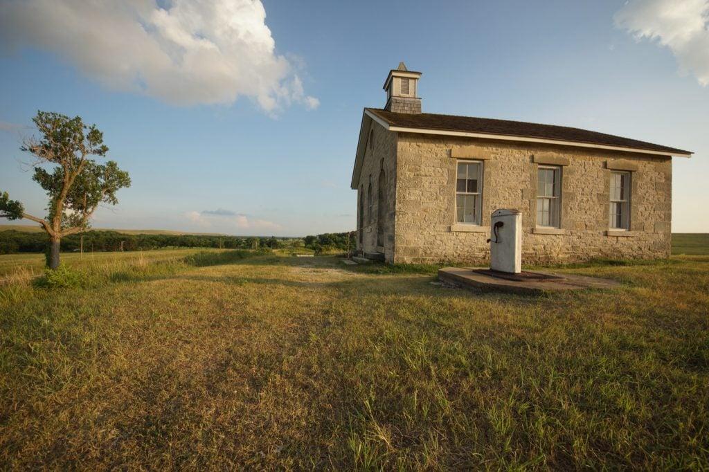 Old historic school house in the open prairies of Kansas
