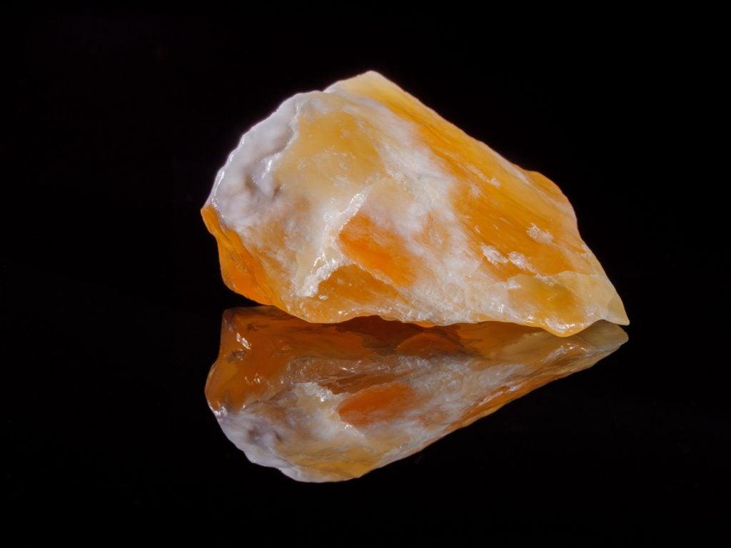 Closeup of Calcite orange on a black background