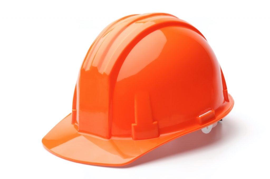 Orange hard hat isolated on white background
