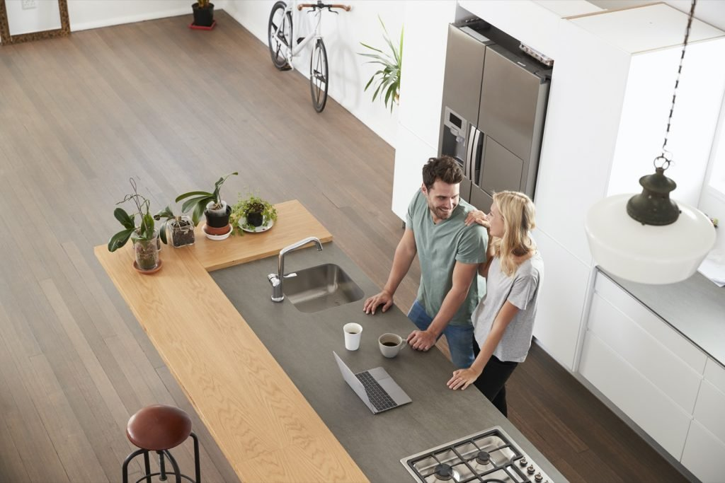 Overhead view of stylish kitchen with slate colored refrigerator