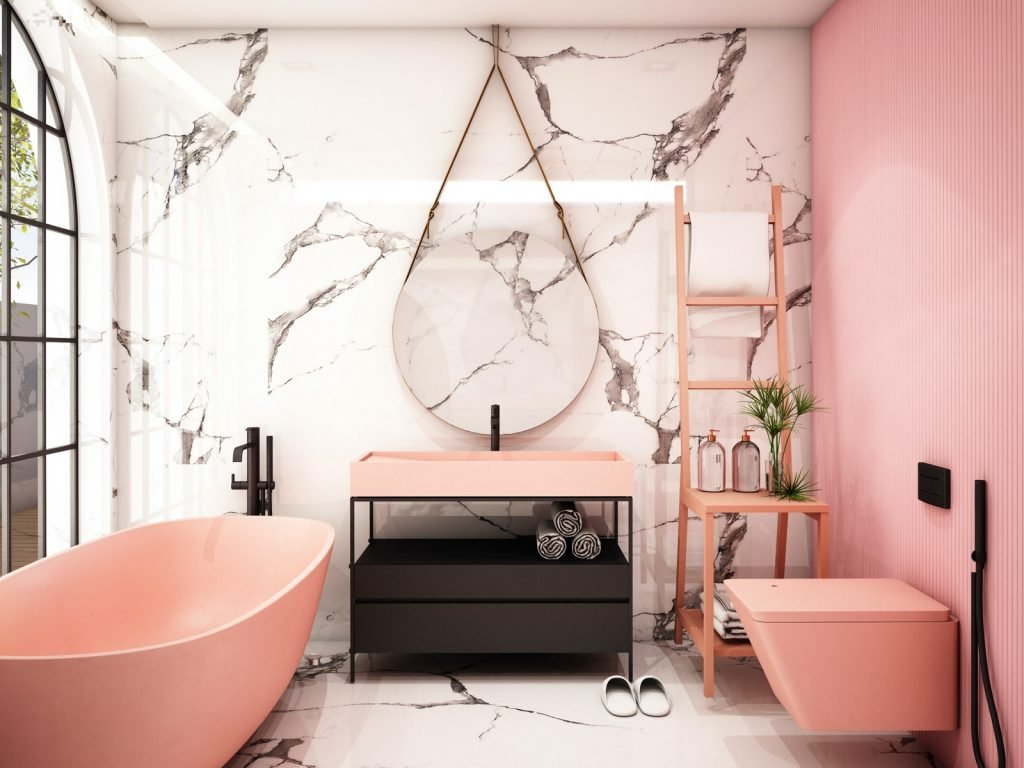 Bathroom interior design with pink painted wall and apricot peach colored toilet, bathtub and sink