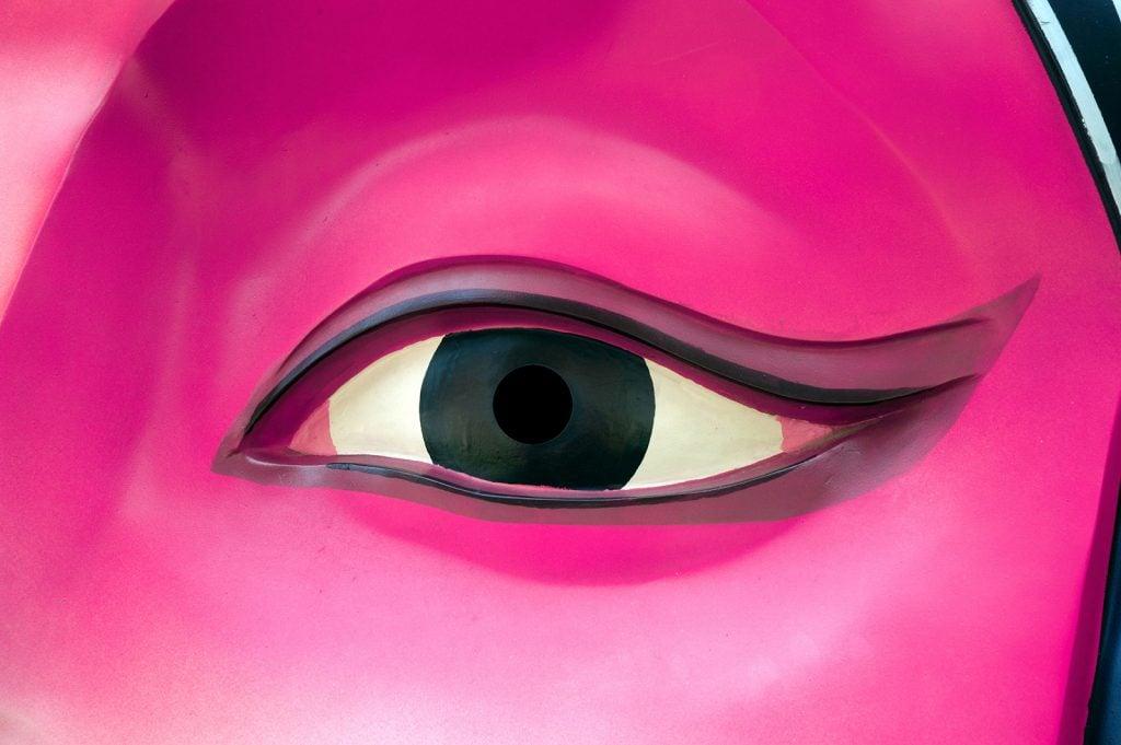 Pink Chinese opera mask close up