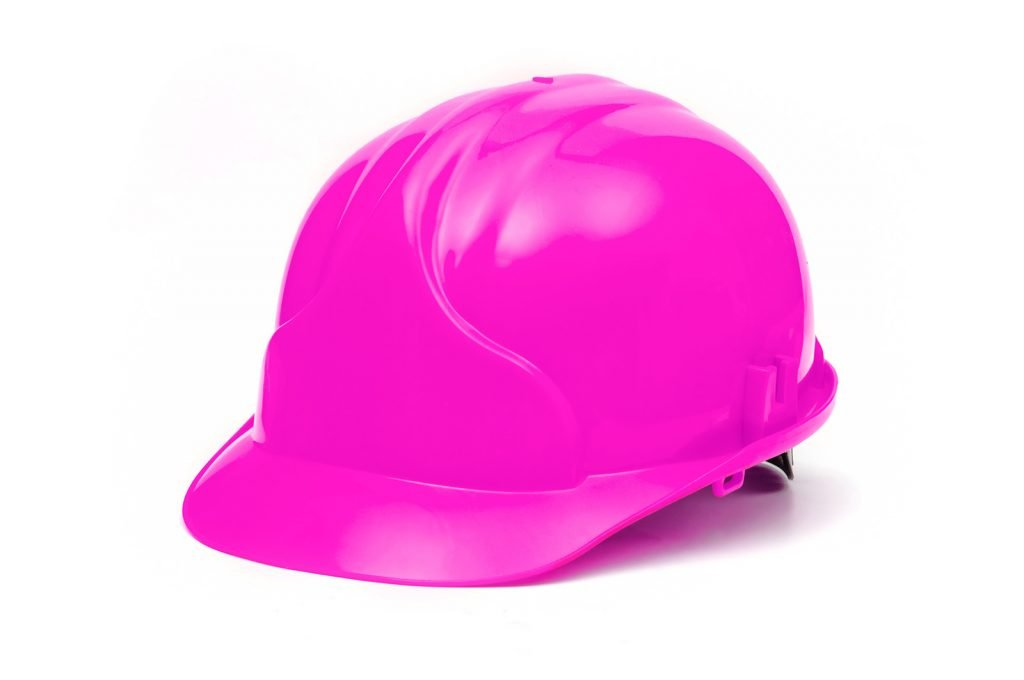 Pink hard hat isolated on white background