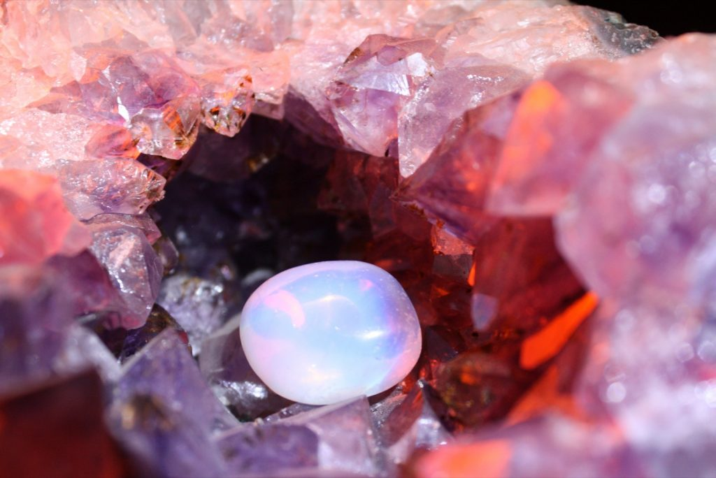 Pink moonstone surrounded by rock crystal