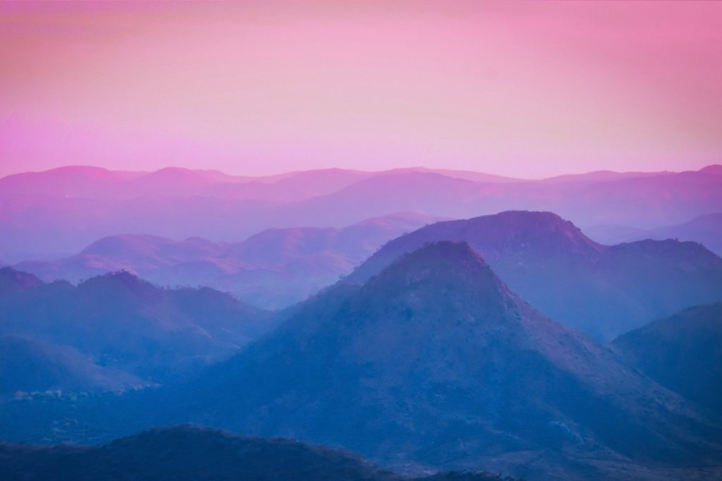 Pink sky over a mountain landscape