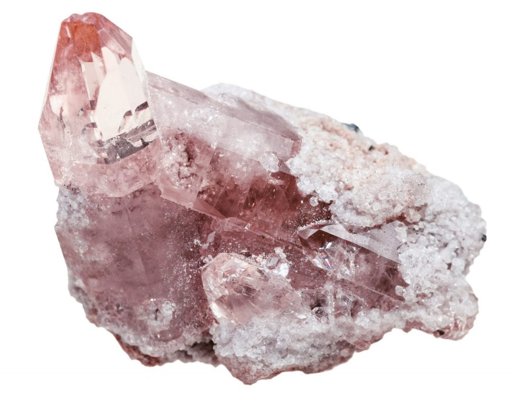 Pink topaz crystal on rock isolated on white background
