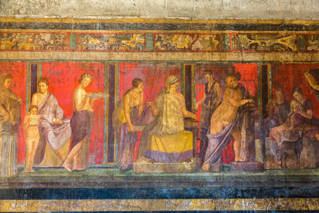 Painted wall in Pompeii city of people with purple garments