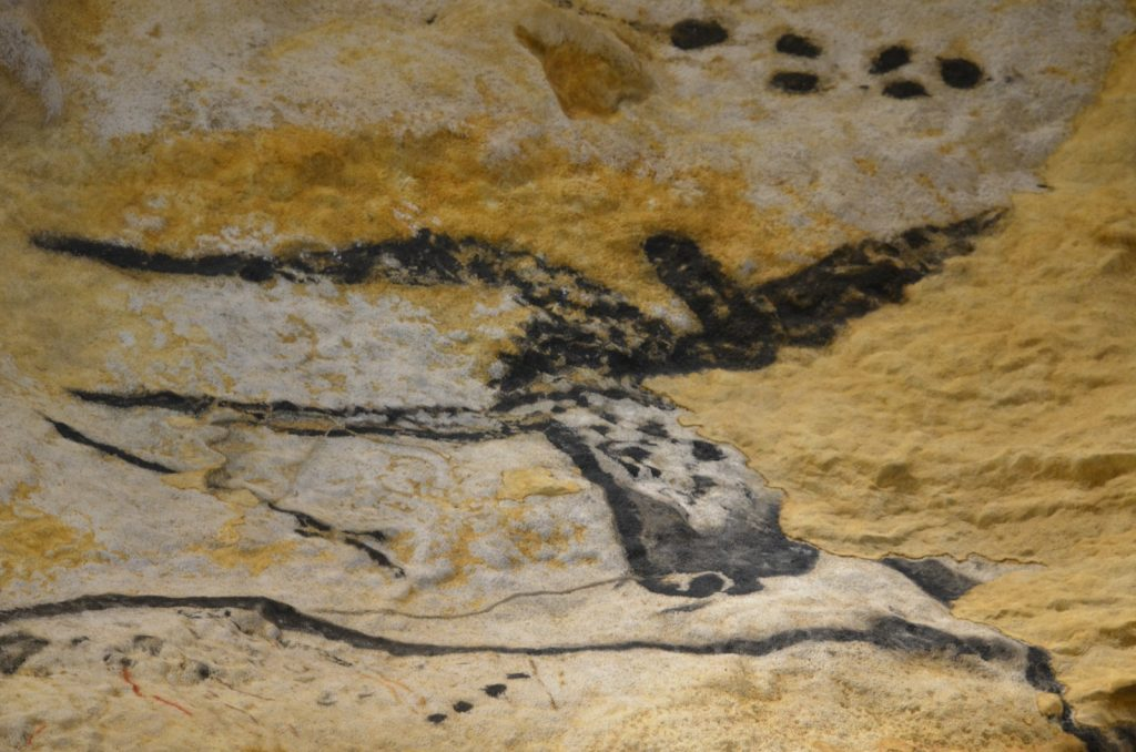 Prehistoric cave painting of yellow bison