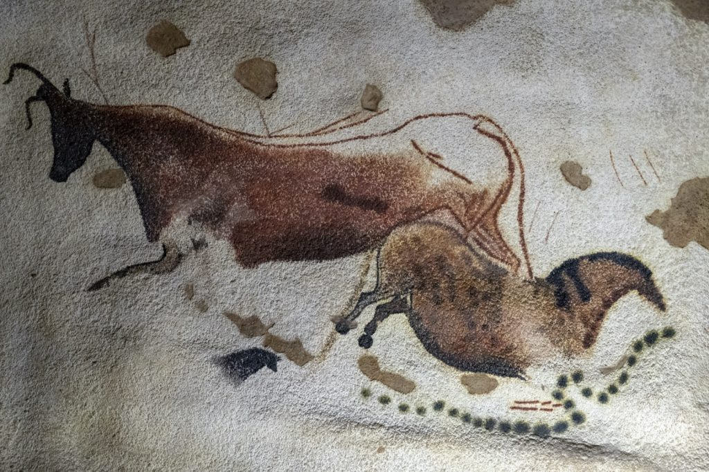 Closeup of prehistoric painting of brown animals in the Lascaux caves in France