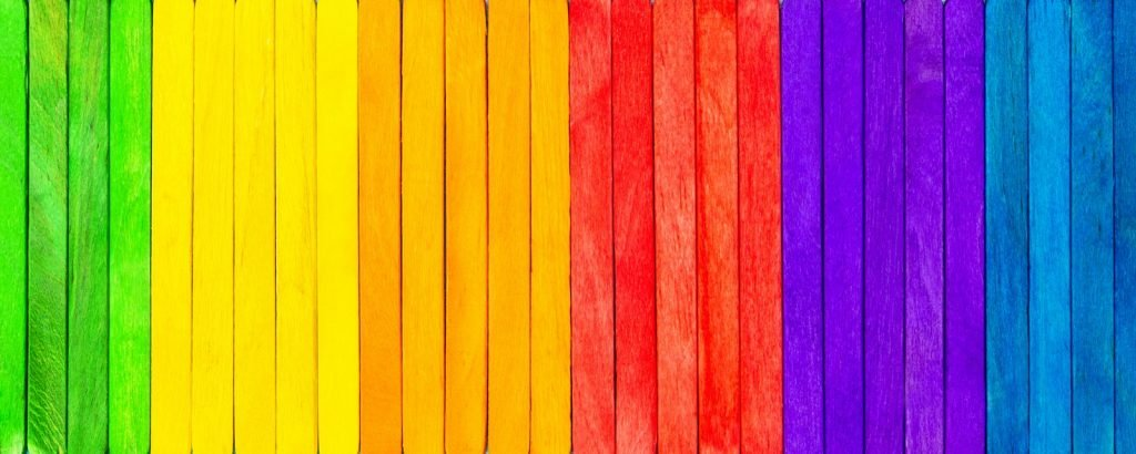Colorful wooden picks painted in primary and secondary colors