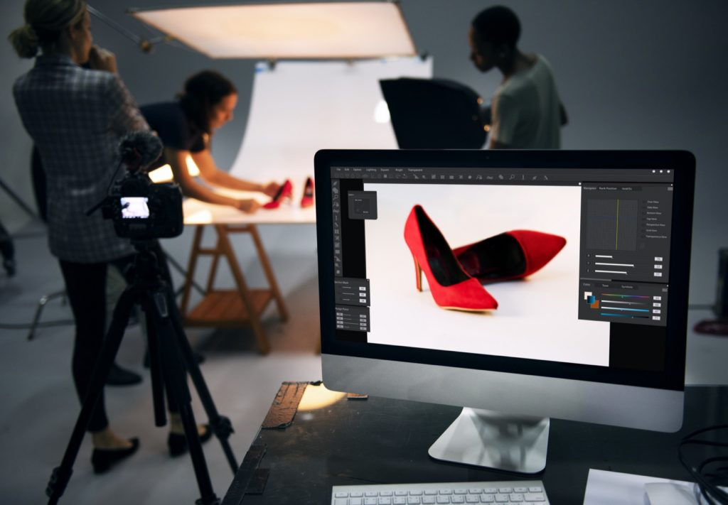 Product photography of red shoes with white backdrop color