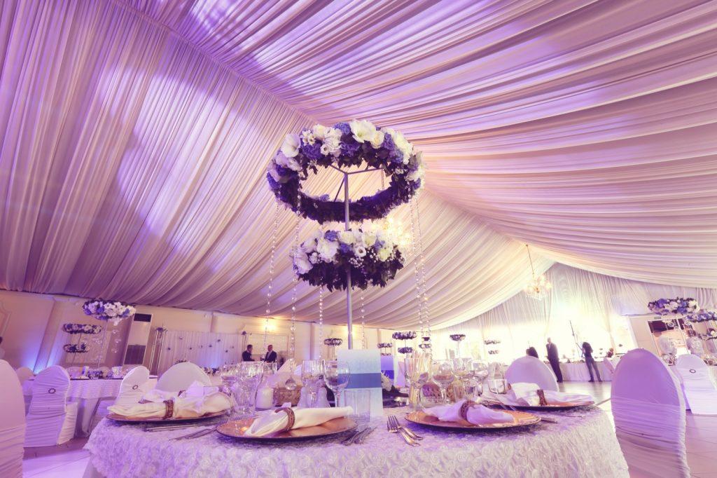 Purple themed wedding decoration in restaurant