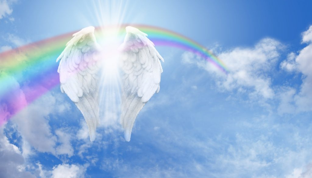 Rainbow angel wings in the clouds