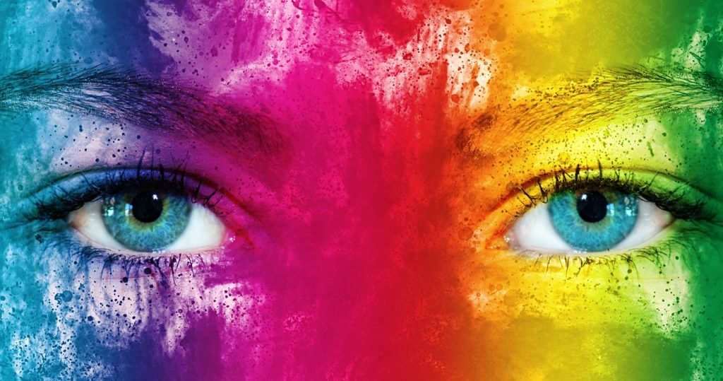 Rainbow colored face with focused eyes