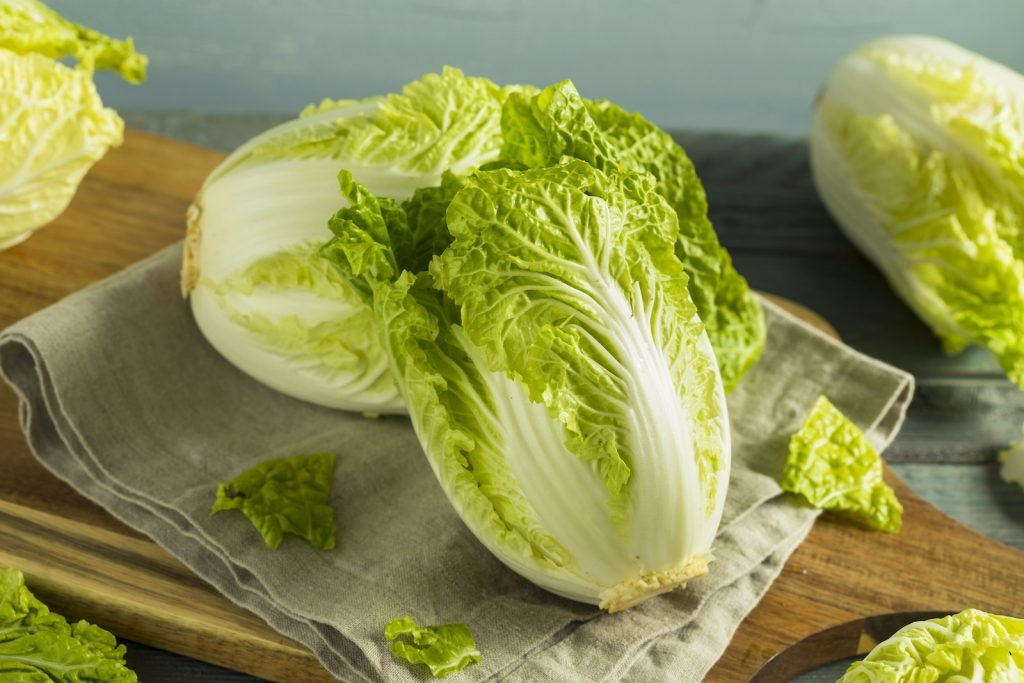 Raw Green Organic Napa Cabbage on  wooden copping board