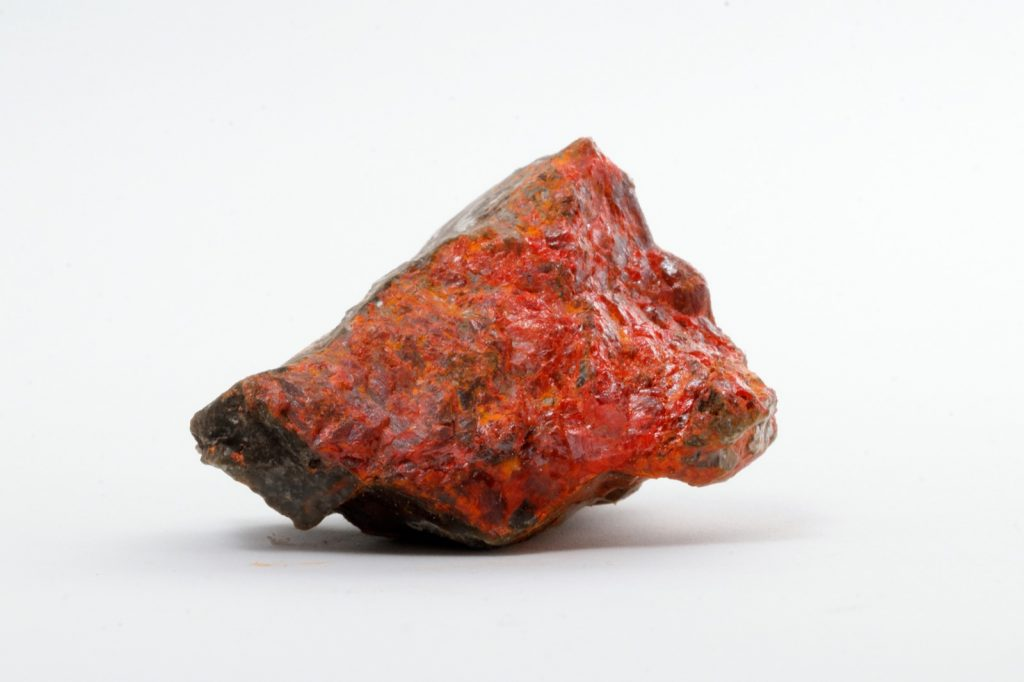 Realgar mineral on stone used to create orange pigment in ancient Mesopotamia