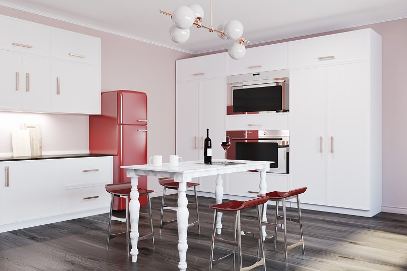 white kitchen with red refrigerator