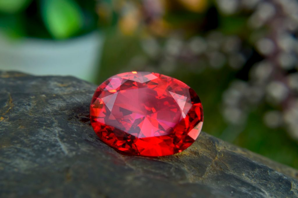 Bright red ruby on a natural background