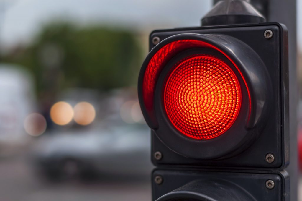 Red traffic light on a busy city street