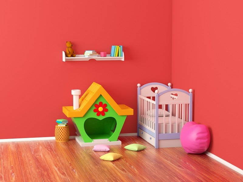 red walls baby nursery room with crib and books