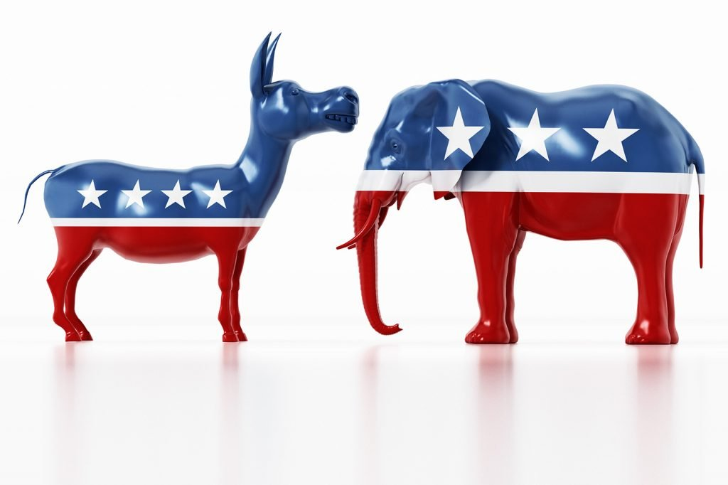 Republican and Democrat party political colored symbols, elephant and donkey