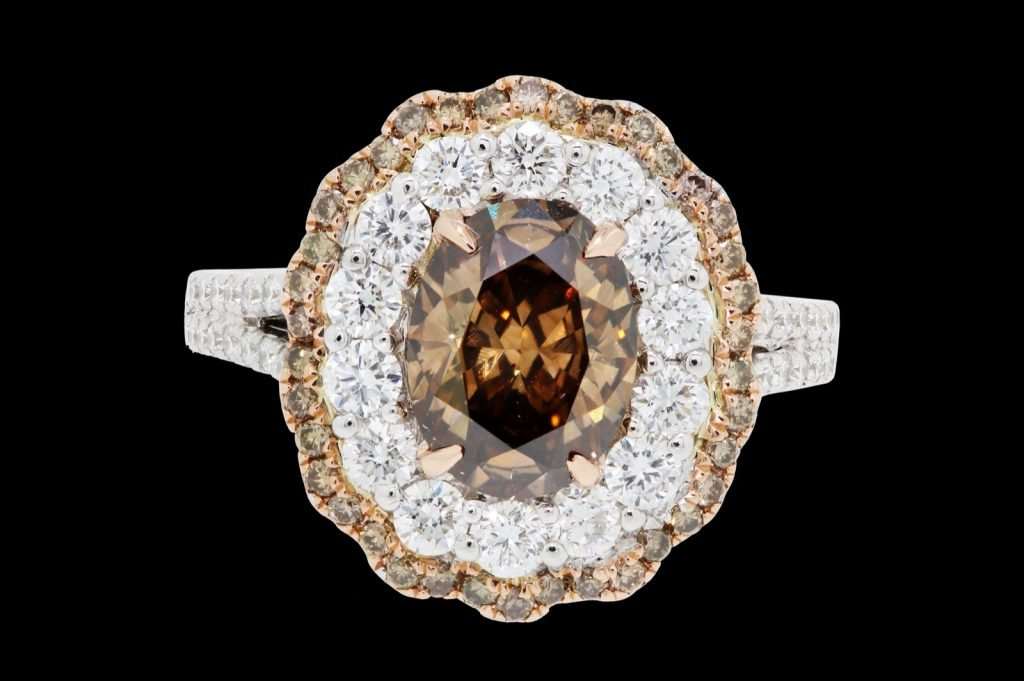 Ring with brown chocolate diamond isolated on a black background