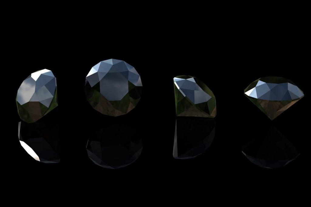 Round black sapphires on a dark background