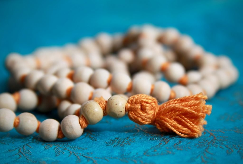 Sacred Indian orange prayer beads