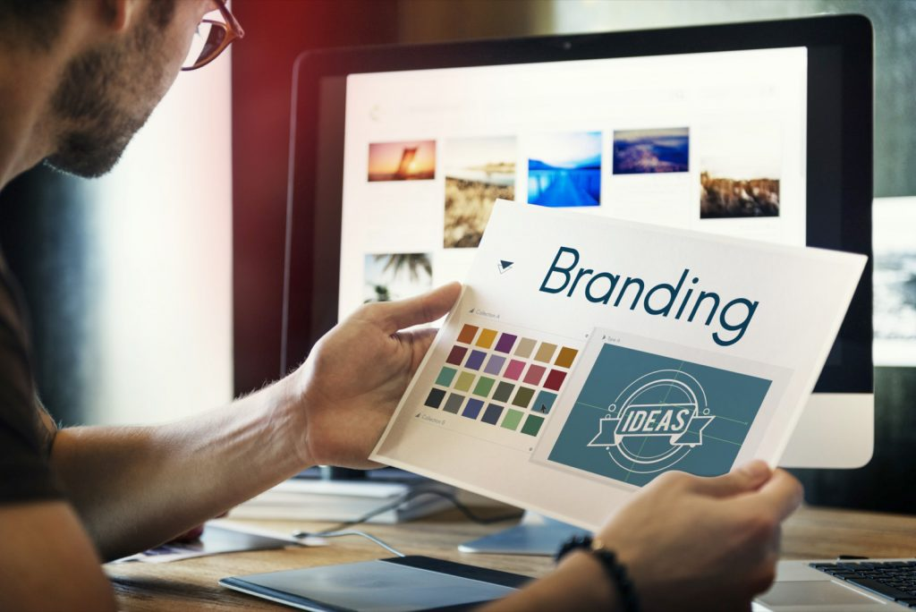 Designer selecting colors for business branding