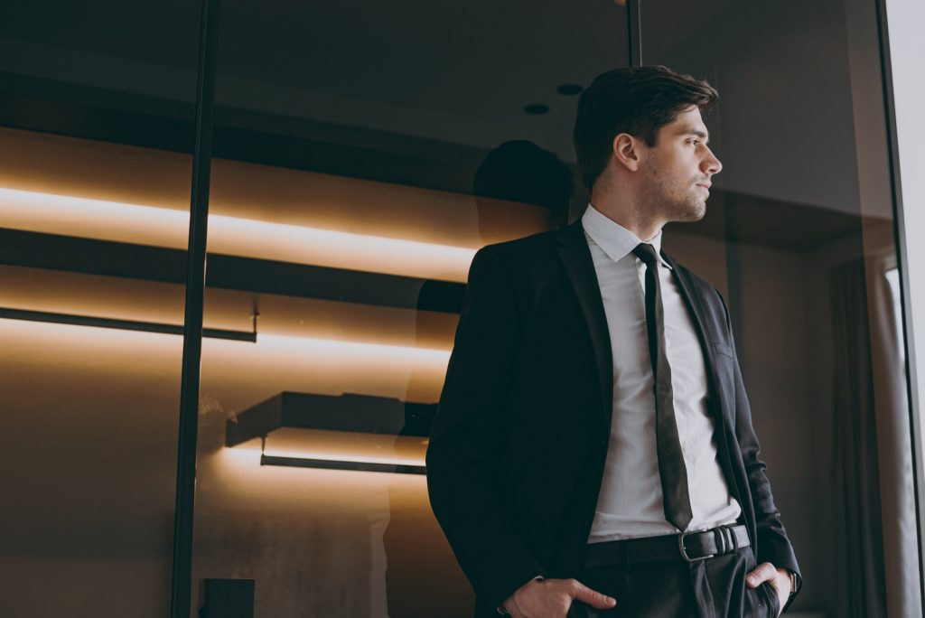 Serious professional businessman in a formal black suit
