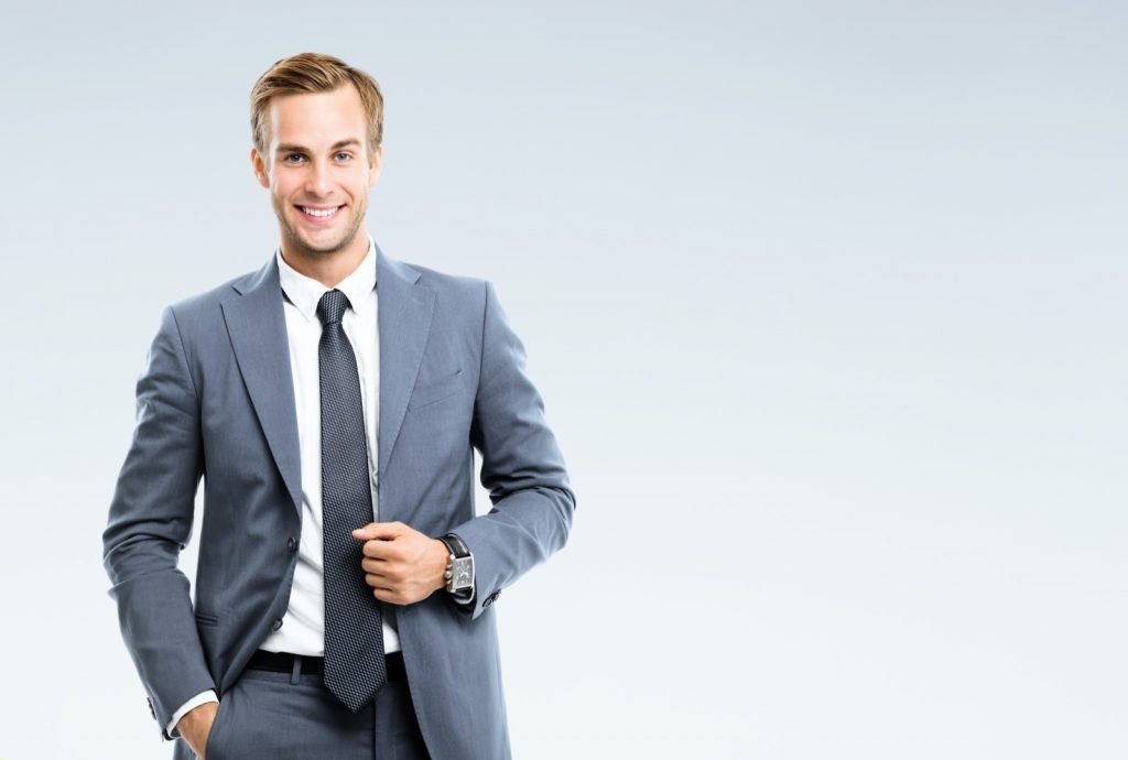 Smiling businessman wearing gray suit and tie