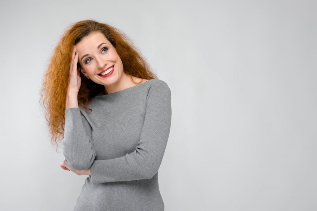 Smiling woman in a gray outfit