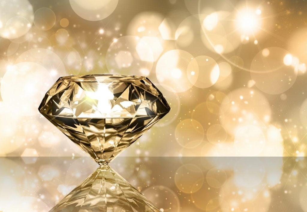 Sparkling diamond on a golden background