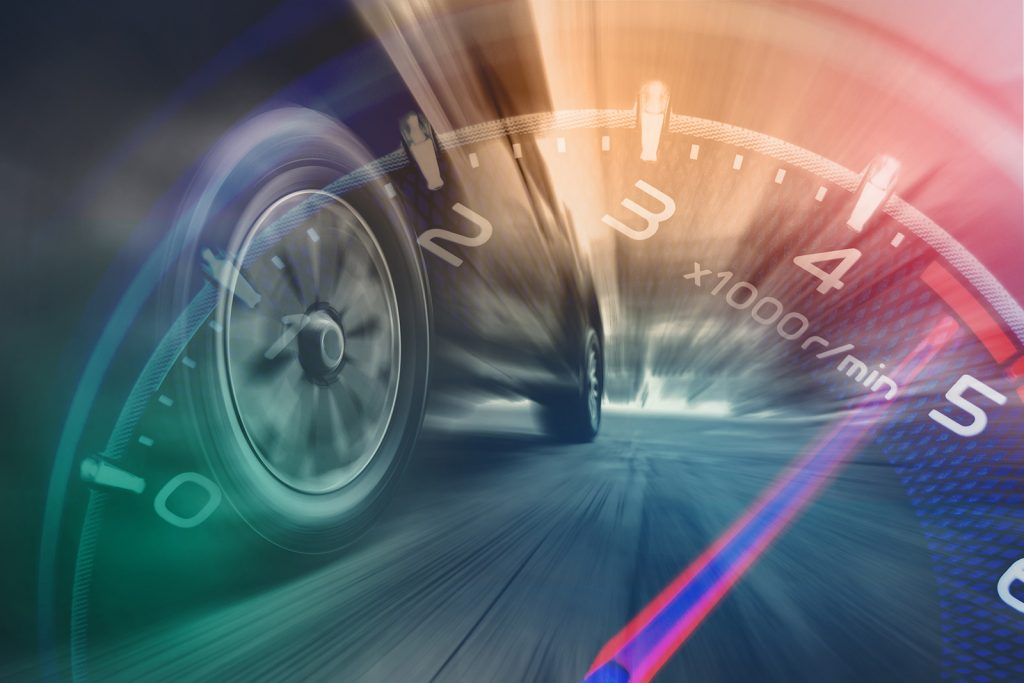Tire view of speeding car and tachometer