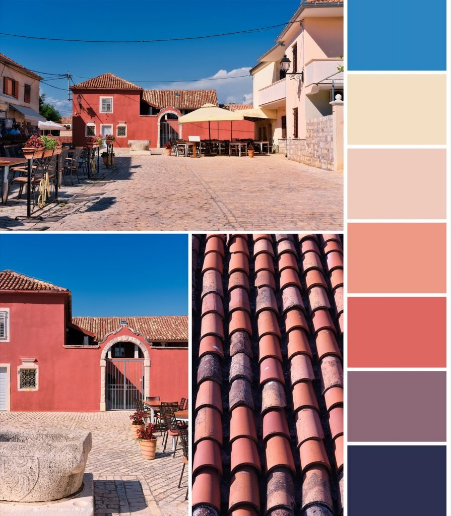 Split complementary color matching palette from traditional sandstone houses with red terracotta tile roofs under blue sky