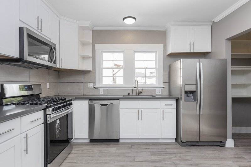 modern kitchen in white with stainless steel appliances