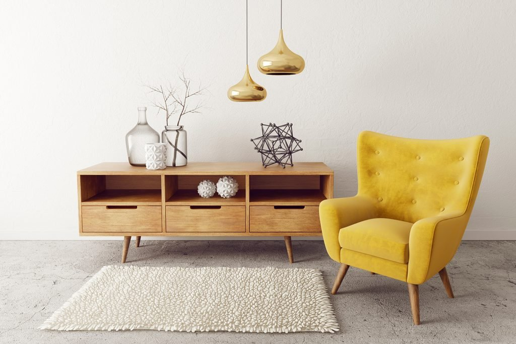 Stylish living room with mustard colored accent chair