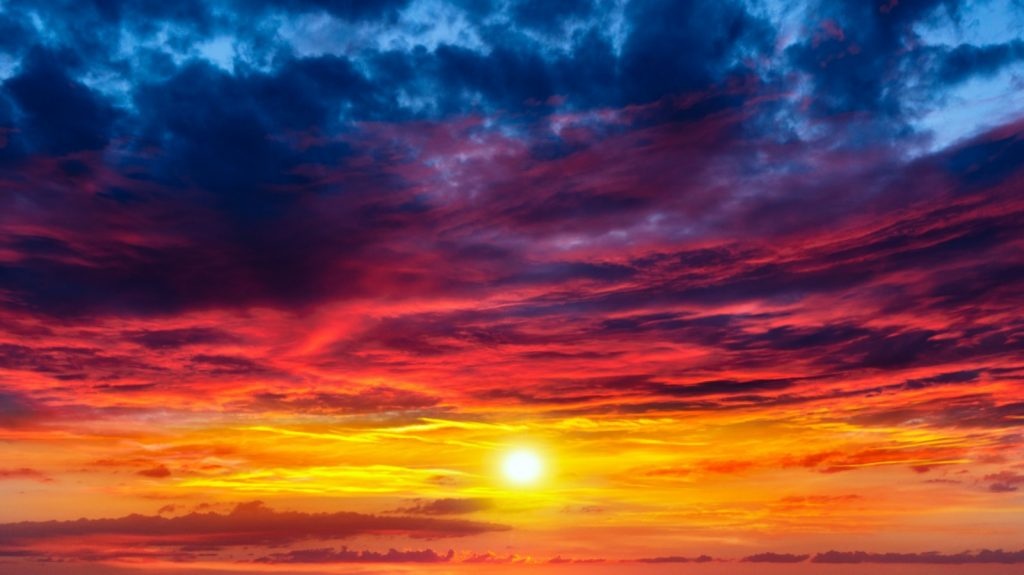 Sunset in blue, red and yellow colors with spiritual meanings