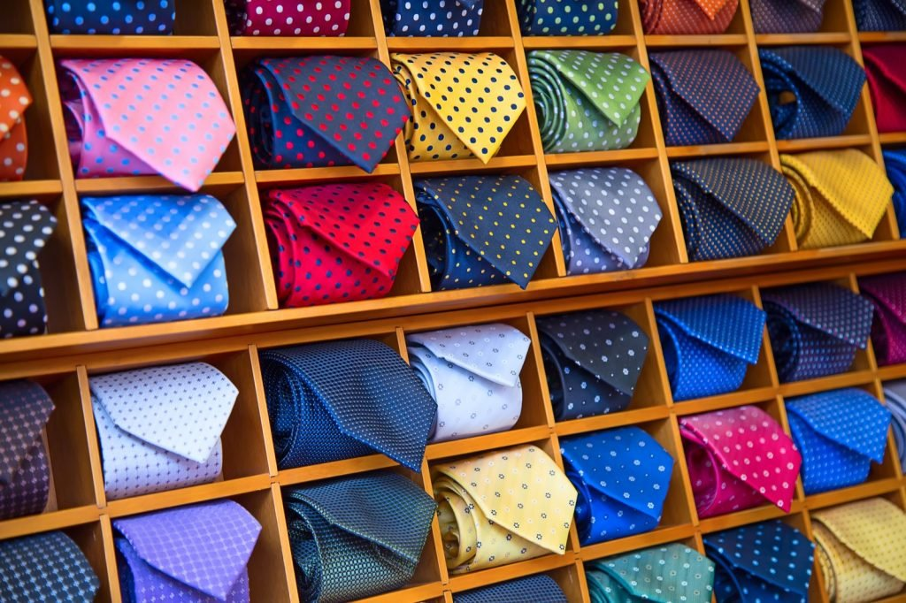 Tie collection with many different colors in mens clothing shop