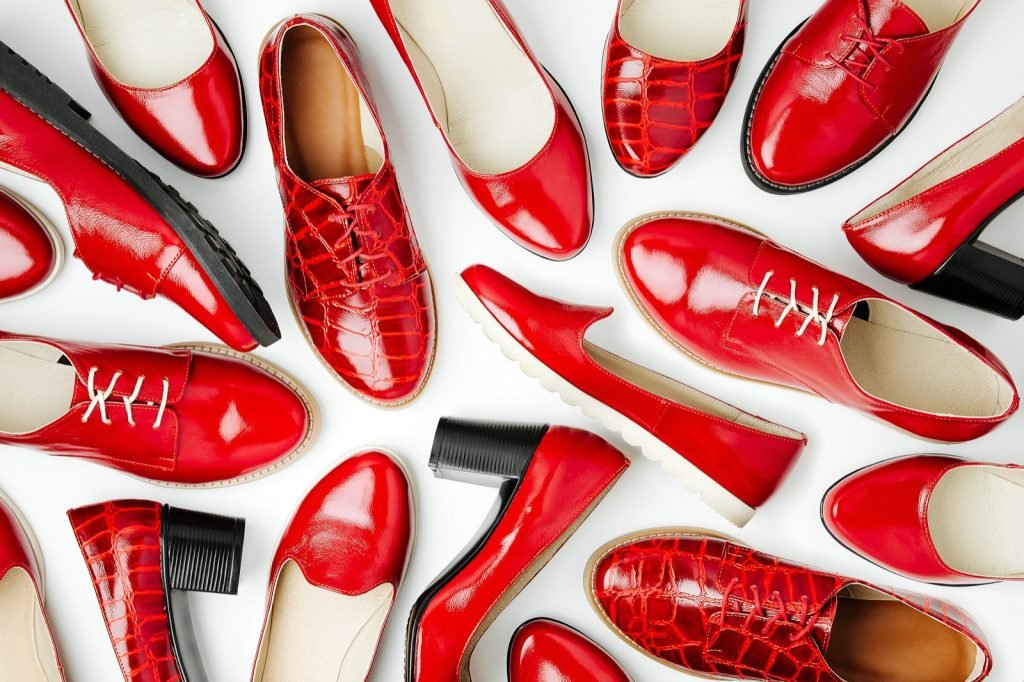 Top view of stylish female spring or autumn shoes in red colors
