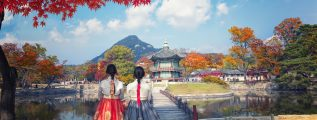 Traditional korean dresses - two women in autumn