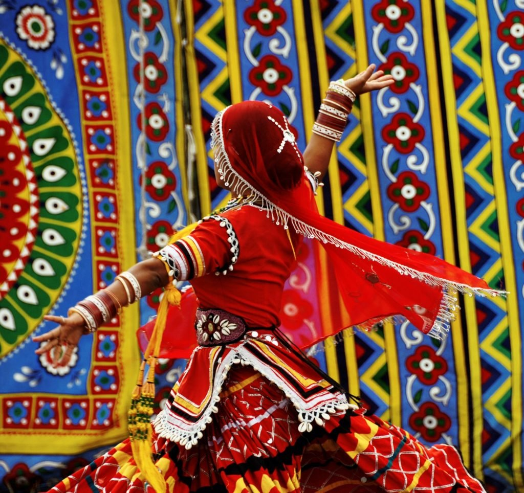 Traditional Pakistani dancer in a red dress