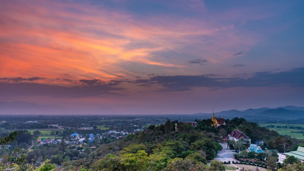 Triadic colors purple, orange and green at sunset sky and clouds in Chiang Mai, Thailand