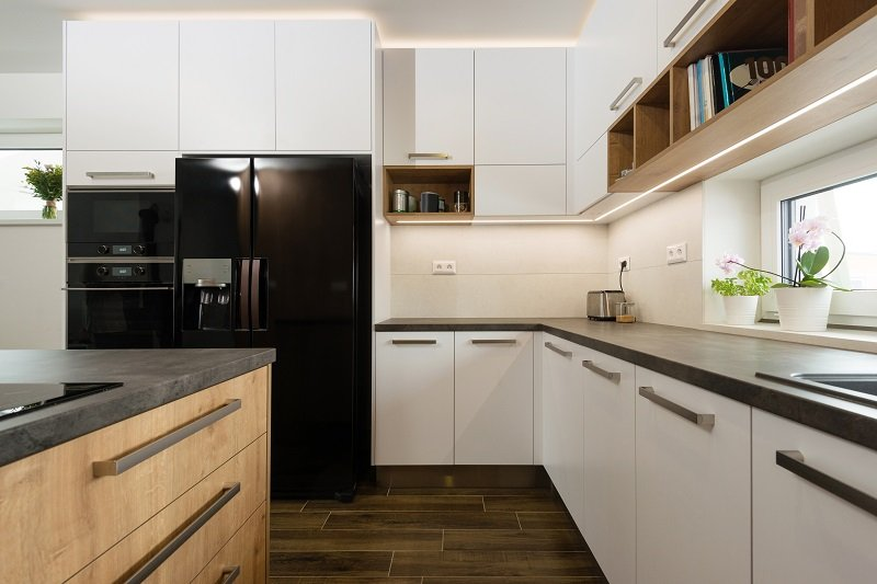 Interior of modern kitchen with truffle brown built-in appliances