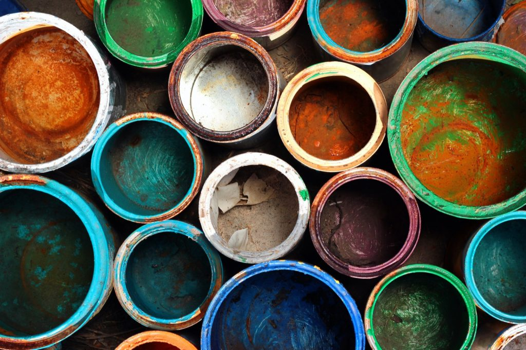 Used historic vintage paint cans in different colors