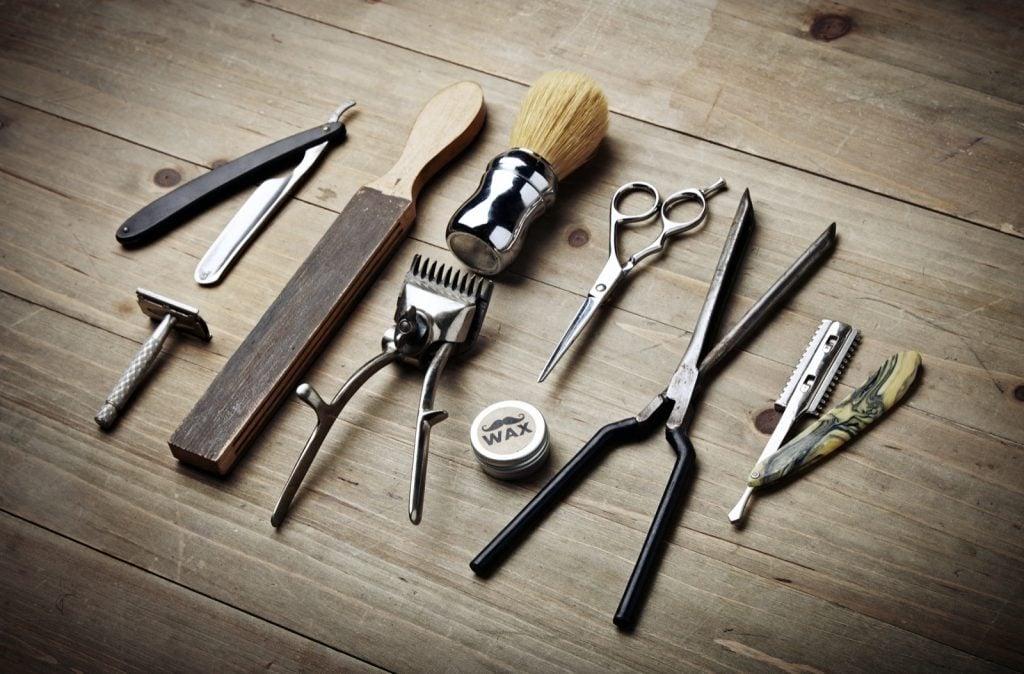 Vintage tools of barber shop on wood desk